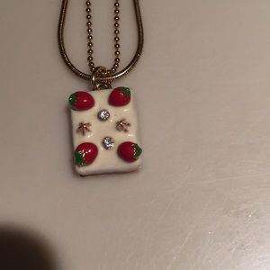 Jewelry - Yummy strawberry glazed cake on goldtone chain.